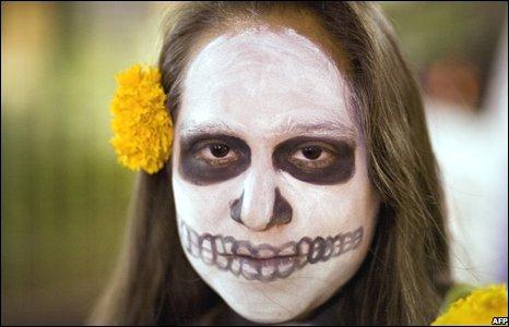 day of dead skull girl. A girl made up so her face