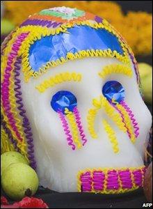A Calaverita - little skull - placed on an altar in Mexico City