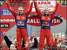 Loeb and co-driver Daniel Elena celebrate the title