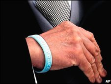 "Prime Minister Aso wears a ""Wings of Peace"" wristband"
