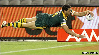 Greg Inglis dives over for his first try of the night as Australia get off to a flying start against England in Melbourne