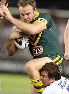 Glenn Stewart hands off a tackler as Martin Gleeson goes for the legs