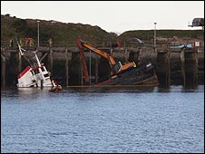 The sinking dredger