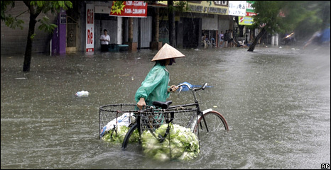 People on a flooded street in Hanoi, Vietnam, 2 November 2008