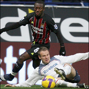 Taylor tackles Wright-Phillips