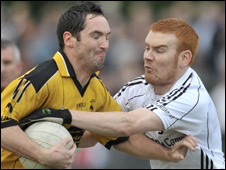 Brendan Devenney tries to hold off Emmett Teague at Coalisland