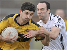 David McGinley (left) is challenged by Clonoe's Aidan Brady