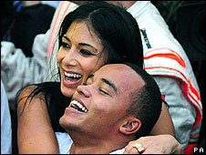 Lewis Hamilton's girlfriend Nicole Scherzinger, of pop group the  Pussycat Dolls, hugs his brother Nicholas after the race