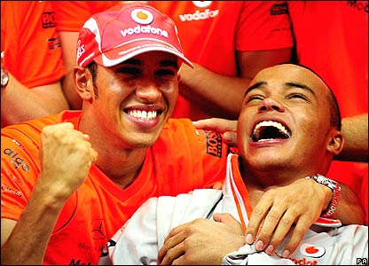 Lewis Hamilton celebrates with his brother Nicholas