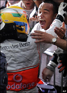 Lewis Hamilton embraces his ecstatic brother, Nicholas