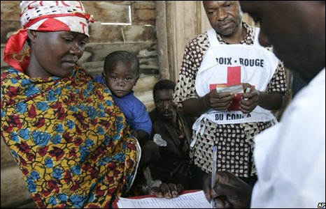 A mother and child are registered at a displaced persons camp Kibati, north of Goma in eastern Congo.
