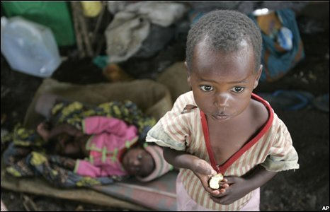 A child eats a banana in an abandoned church in Kibati, north of Goma in eastern Congo