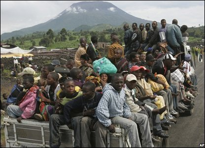 Residents are transported on a truck as they try to reach their homes near Kibati, north of Goma in eastern Congo.