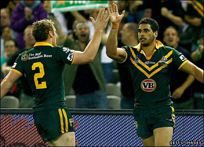 Joel Monaghan and Greg Inglis celebrate another Australian try