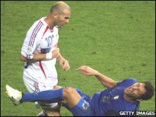 Marco Materazzi falls to the ground after being headbutted by Zinedine Zidane