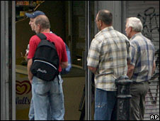 Poles wait on a street corner for employment in London. File photo