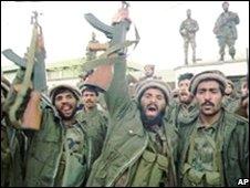 Mujahideen soldiers celebrate victory