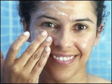 Woman applying sunscreen (SPL)
