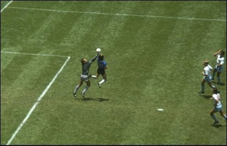 Diego Maradona scores against England in the 1986 World Cup