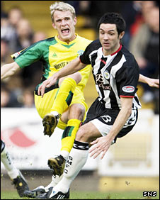 Dean Shiels is challenged by St Mirren's Gary Mason on Saturday