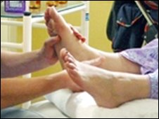 Reflexologist massaging a foot