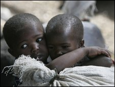 A young boy protects his sister at a displaced people's camp north of Goma, DR Congo, 3 November 2008