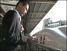 Japanese man at a station