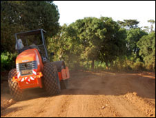 A tractor grading the road to Kogelo