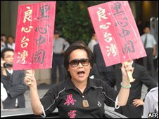 Anti-Beijing protester calls for a boycott of Chinese-made products in Taipei on Tuesday