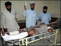 A local resident caught up in the fighting in Swat is taken to hospital