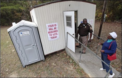 A sherrif arrives to cast his vote in Bullock County, Smut Eye, Alabama.
