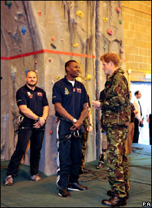 Prince Harry chats to Ben McBean who lost an arm and leg in combat in Plymouth.
