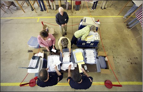 Deputy warden Frank Stearns, top, oversees the counting of absentee  ballots, Camden, Maine.  However half the town's registered voters cast their ballots ealry.