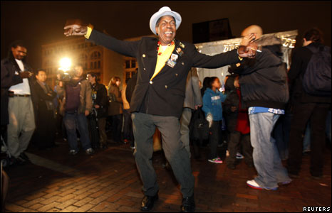 Gene Rounds dances as he attends an outdoor election-night gathering to watch the returns of the US presidential election come in on 125th Street in the Harlem district of New York City