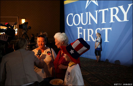 A guest is interviewed during the election-night rally of Republican presidential nominee US Senator John McCain
