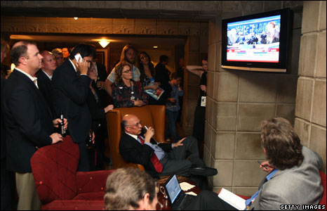 Guests watch polling results on television during the election-night rally of Republican presidential nominee US Senator John McCain