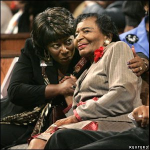 Georgia Representative Roberta Abdul-Salaam (L) hugs Christine Farris King, who is the sister of slain civil rights leader Martin Luther King, Jr., at Ebenezer Baptist Church