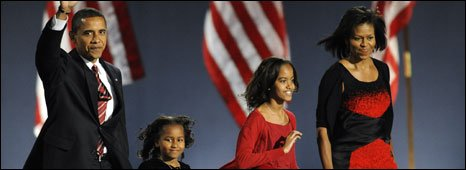 Barack Obama with his family accepting victory in Chicago