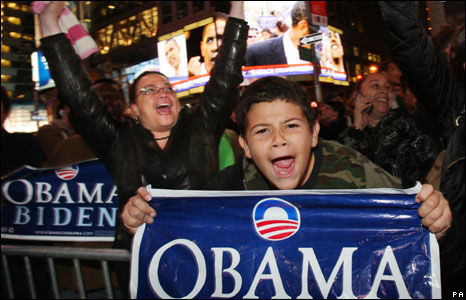 People celebrate in New York's Times Square as Barrack Obama is confirmed as President Elect of United States of America.