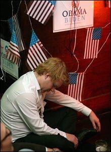 Man snoozing at election night party
