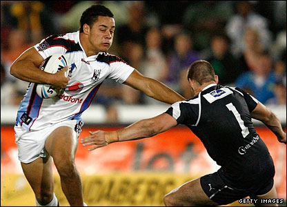 Fiji's Jarrod Hayne steps past Michael Robertson