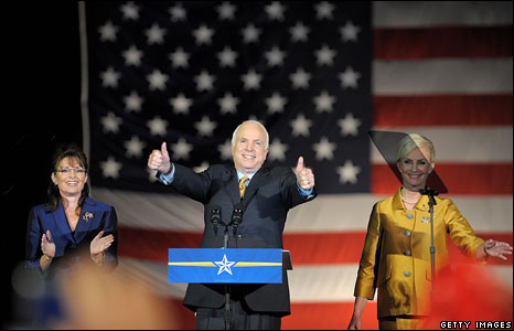 Flanked by his wife Cindy and his running mate Sarah Palin, McCain addressed his supporters in Phoenix.
