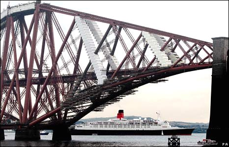 The QE2 docks near the Forth Rail Bridge in Scotland in October 2008.