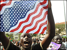 Kisumu residents wave a US flag in celebration of Barack Obama's victory in the US presidential race