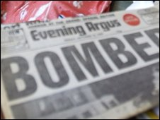 Newspaper featuring bomb headline