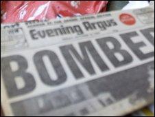 Newspaper featuring bomb headline