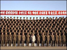 In this undated photo released by the North Korean Central News Agency (KCNA) on Wednesday, North Korean leader Kim Jong-il (wearing pale jacket in front row) poses with North Korean officers and soldiers