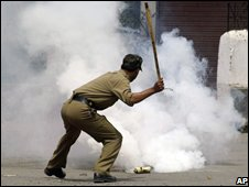 A policeman during last summer's vioence in Indian-administered Kashmir