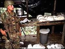 A soldier guards cocaine in Colombia