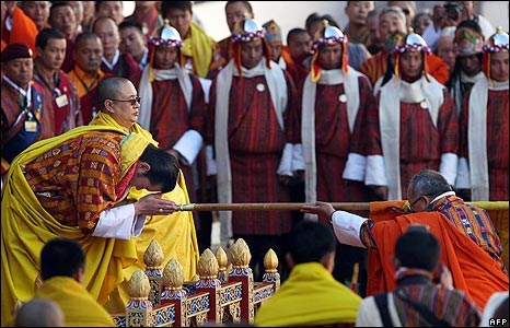 Jigme Khesar Namgyel Wangchuck is blessed by a priest before the coronation ceremony